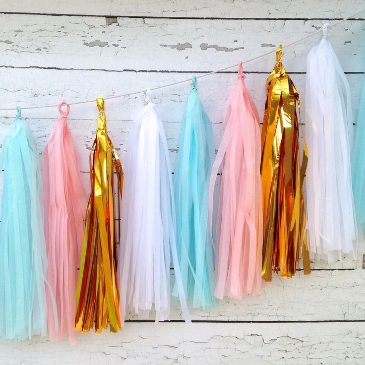 Is it a boy or girl? The suspense is almost unbearable! If you are planning a gender neutral baby shower or a gender reveal party you need this darling tissue tassel garland. WOW your guests and the s