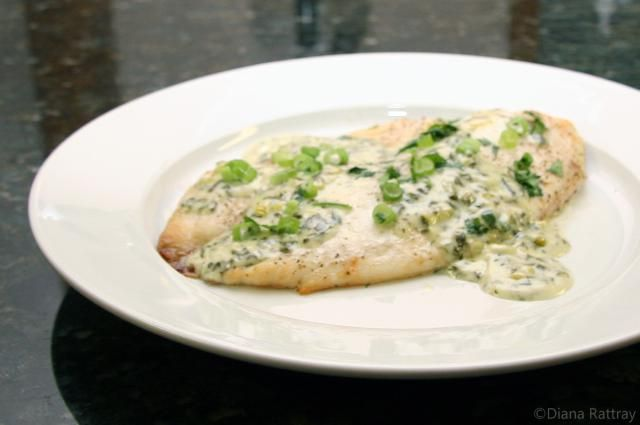 Tilapia bakes quickly and makes a delicious meal with a baked potato or rice. This preparation uses a simple cream sauce with cilantro (or parsley) and green onions. Delish!.