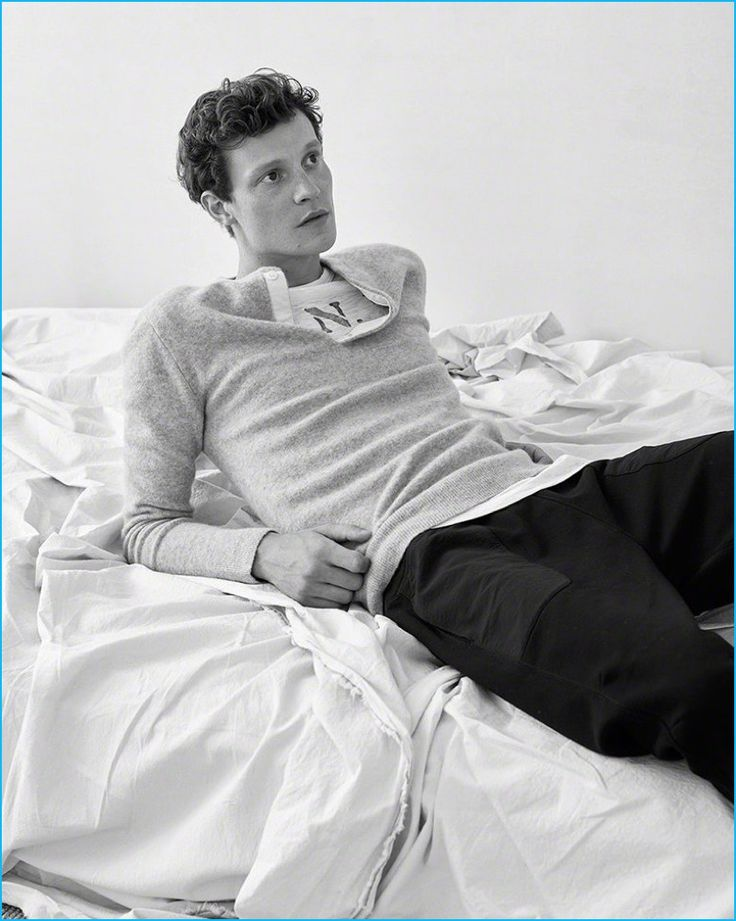 Matthew Hitt goes casual in a henley, graphic t-shirt, and sweatpants from Abercrombie & Fitch.