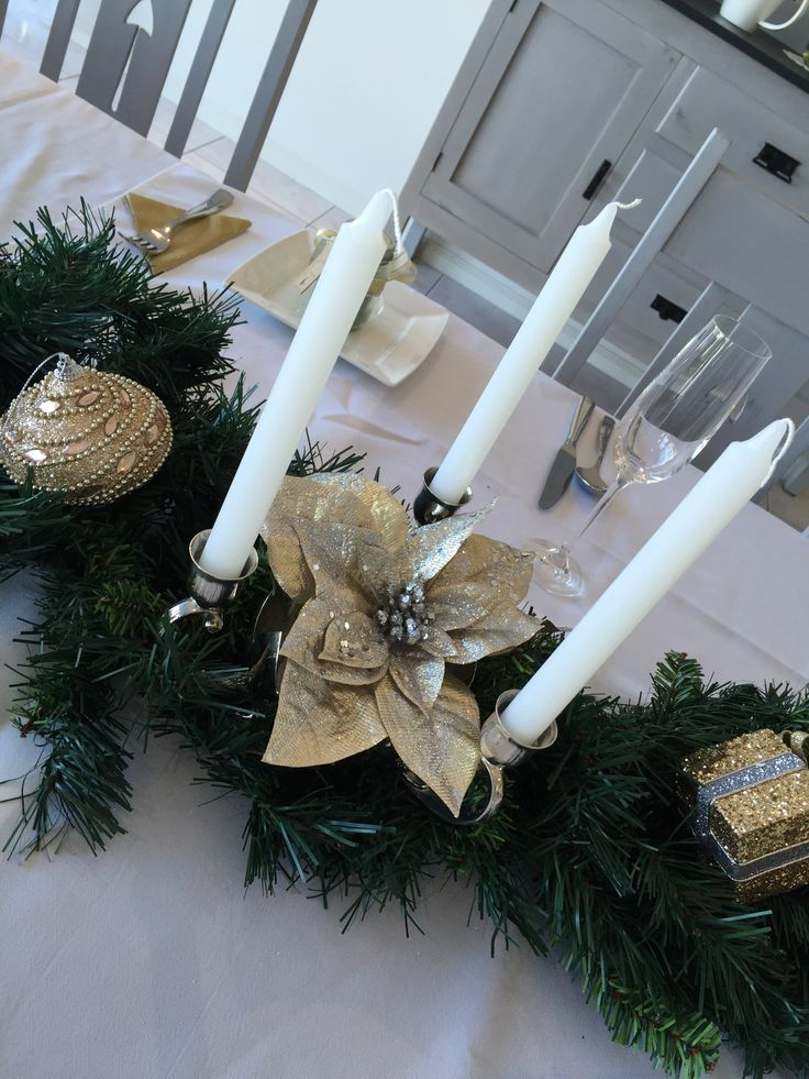This is some of Great Grannys Candle sticks Up-cycled and some $2 candles from the discount store. Thrown in with a Christmas Garland, it was an elegant look.
