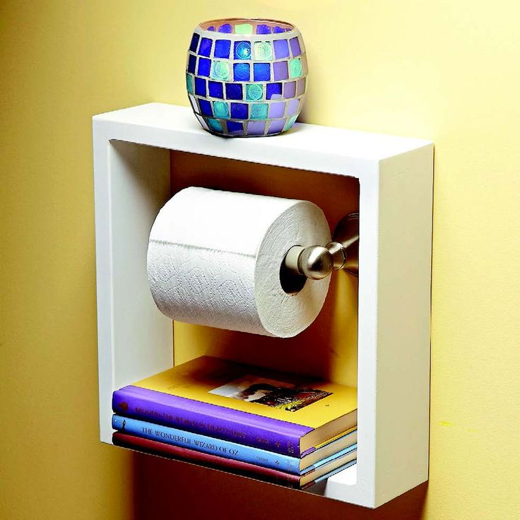 Toilet Paper Shelf  Here's a clever idea for a small bathroom shelf. Build or buy a deep picture frame and hang it around your toilet paper holder. It will give you two convenient shelves for small items in your bathroom where every inch of storage counts.