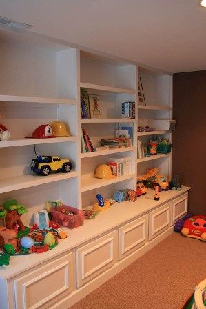 Basement idea - since my kids are beyond the baby/toddler toys we could do legos, board games, videos, etc on the shelves. Wouldn't be the basement in my house, though...