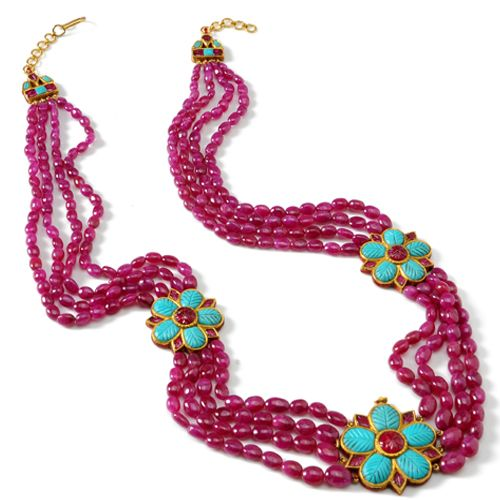 Gold 4-strand necklace with rubies and 3 motifs of carved turquoise and spinel. [Ruby String: 310 ct Turquoise: 10.89 ct Ruby Motif: 15 ct]