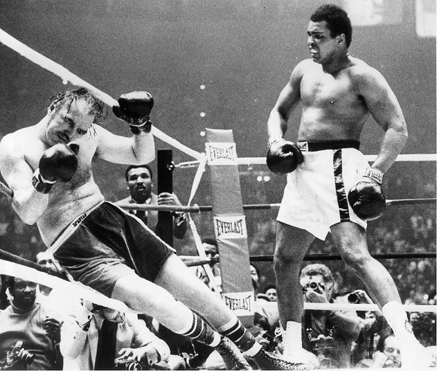 Muhammad Ali watches Chuck Wepner fall to the canvas @ Richfield Coliseum (Cleveland, Ohio) in the 15th round, 24 March 1975. | CSU Encyclopedia of Cleveland History