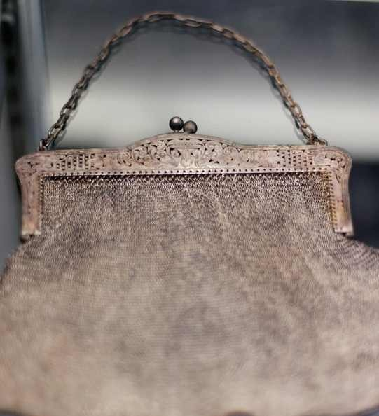Titanic artifacts-  I have an antique purse very much like this hanging on the bedroom wall...