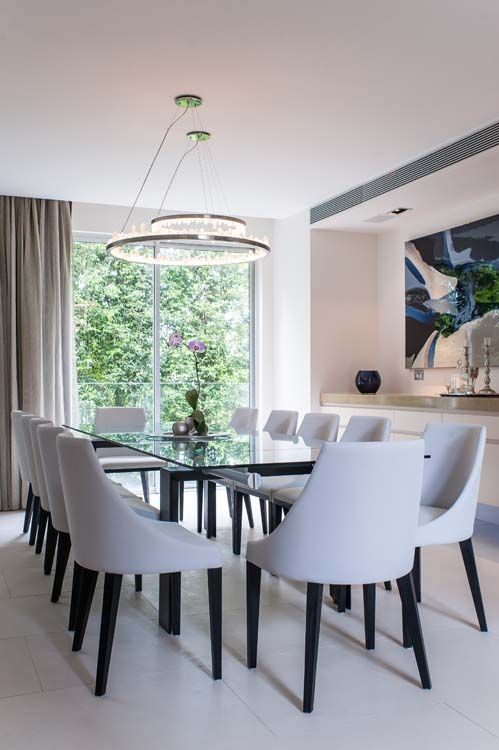 Crystal chandeliers create a massive wow-factor in this dining area | At home with Kelly and Rodney | Home Ideas magazine
