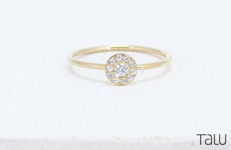 A personal favourite from my Etsy shop https://www.etsy.com/listing/513420083/diamond-ring-gold-diamond-ring-circle