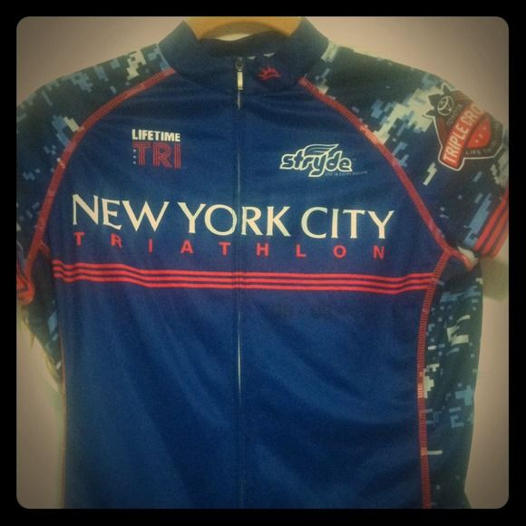 💥Reduced💥2014 NYC TRIATHLON Cycling Jersey Cycling jersey from the NYC Triathlon on 08-03-14 worn once as official merchandise vendor. Women's jersey size S. Slight pull in front as pictured.  Event sponsor logos. Three pockets in back to secure items while cycling. Posh rules please. Thanks for looking!😘 Primal Tops