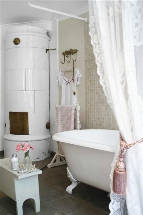 Romantic country bathroom ~ Love that water heater in the corner (could be a stove either way I love it)