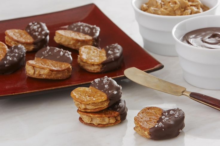 Sweet and salty flavors combine in these chocolate-coated, pretzel crackers sandwiched around a peanut butter filling.