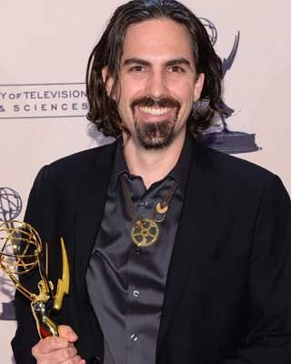 """Actually, I'm pleased to announce that Bear McCreary will be doing the music,"" says ""Outlander"" EP Ron Moore."