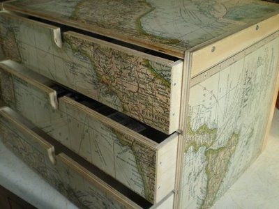 a 3-drawer Ikea FIRA decoupaged with map paper.  <3 <3 <3