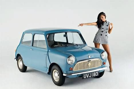 Classic Mini Cooper in a Sky Blue with a 70s stylish model girl