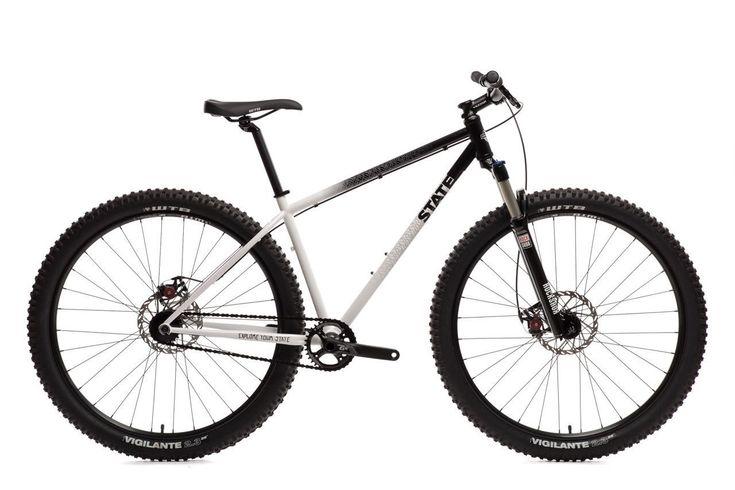 "Deluxe Pulsar SS 29er Mountain Bike Frame: 4130 Chromoly Steel w/ ""Pulsar"" graphics by DKLEIN Fork: Rockshox Recon Silver TK - Solo Air Wheels: WTB SX 19 29'' Rims - 32H Disc Hubs Tires: WTB Vigilante"