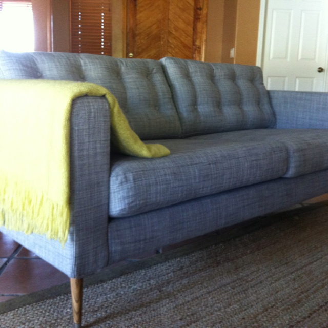 Our $67 IKEA Karlstad sofa hack! :) $12 legs, $7 stain, $48 tufted cushions.