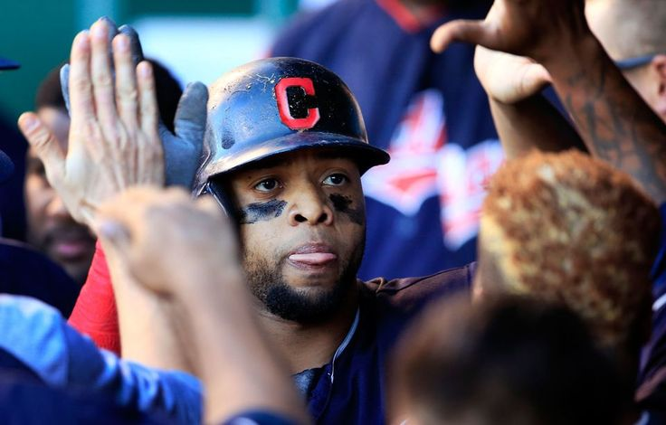 Cleveland Indians designated hitter Carlos Santana celebrates with teammates after his solo home run during the ninth  against the Kansas City Royals at Kauffman Stadium in Kansas City, Mo., Saturday, May 6, 2017. The Indians defeated the Royals 3-1. (AP Photo/Orlin Wagner)