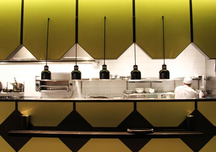Kitchen pass. The use of colours and shapes draws the attention away from the kitchen itself.
