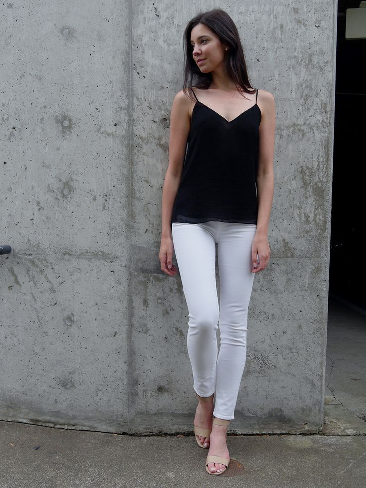 Dress up your white jeans with strappy sandals and a slinky top. We're loving these Paige Skyline Skinnies in Optic White  Get our tips for finding the perfect-fitting white denim.