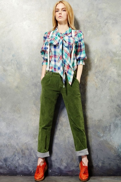 Plaid bow blouse, green velour pants and brownish-orange Oxford shoes.