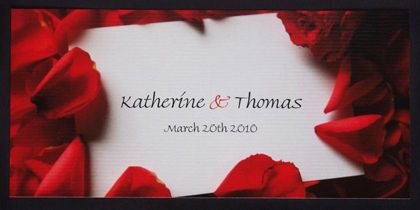 This simple but elegant wedding invitation design features rose petals sprinkled around the couple's name. The details of the celebration are printed on the other side. www.kardella.com