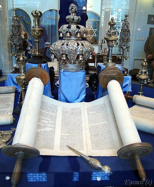 "Display at ""Zsidó Múzeum"" (Hungarian Jewish Museum and Archives) in Budapest. -Torah (תּוֹרָה) scroll is the central and most important document of Judaism. -Torah pointer is a decorated rod used in a synagogue. -Torah finials (the rimonim) are the oldest of the Torah ornaments, means ""pomegranates"", the symbol of fertility and life in much of the Eastern world."
