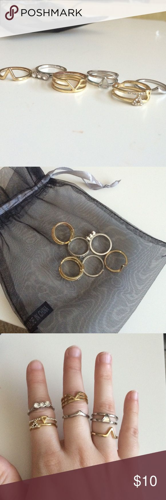 Buckle Festival Ring Set Set of 6 rings (3 silver, 3 gold) all size 7! Only worn once or twice. Like new condition and comes with black jewelry bag! Buckle Jewelry Rings