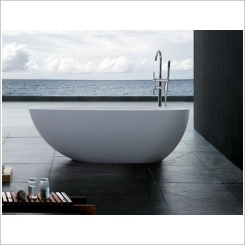 Maybe something like this for the master ensuite? I'm still concerned about the wood near the tub though... Kids probably want to bathe in that too...  Kander Bahama 1700 Stone Bath