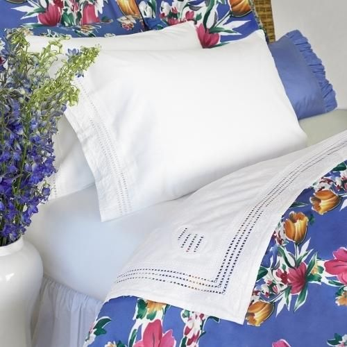 "Fine bands of openwork and superb hand-embroidered details embellish the ends of luminous 400-thread count white sheets. Flat sheet and pillowcase: 4"" hem. Fitted sheet: designed to... More Details"