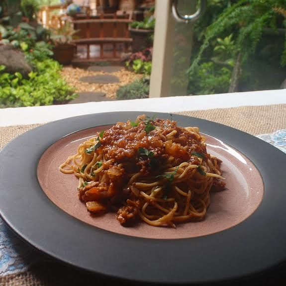 angel hair pasta with bolognese sauce.