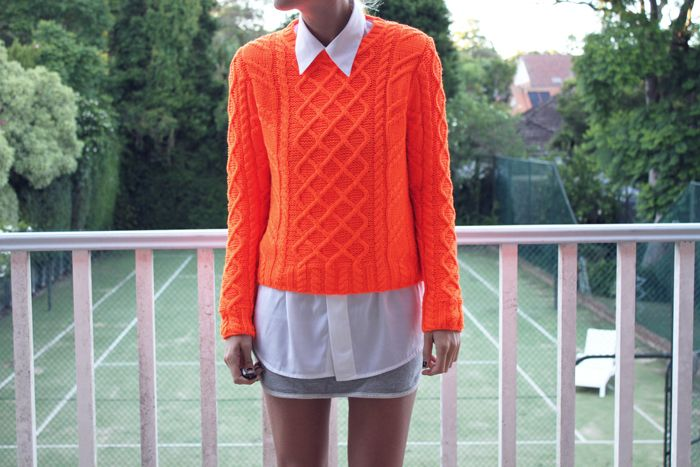 knit tangerine sweater layered over buttoned up oxford {the uniform}