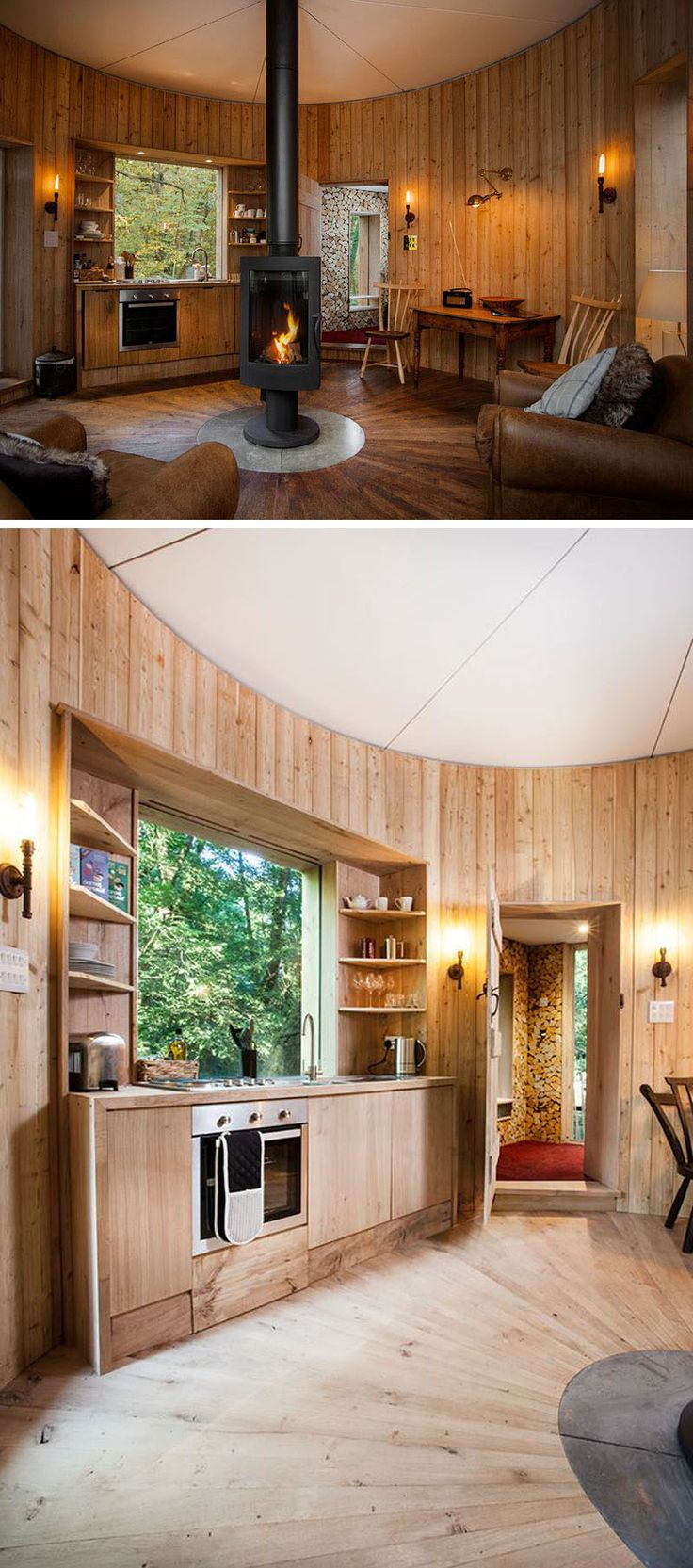 This modern treehouse has a living area with a central fireplace, comfortable seating and a kitchen area with a large window.