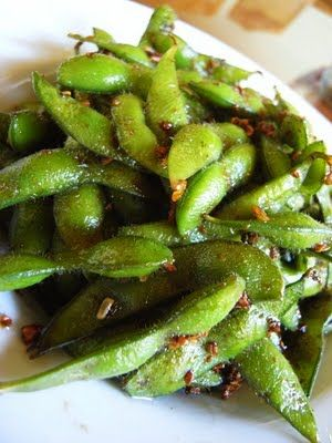 Easy Garlic Edamame:  1 pound frozen edamame;   2 tablespoon finely minced garlic;   1 1/2 tablespoon soy sauce;   2 tablespoon olive oil;   1 teaspoon sesame oil;   1 teaspoon Japanese red pepper (can omit if want to avoid spicy food);   1 teaspoon sugar;  Ground black pepper to taste