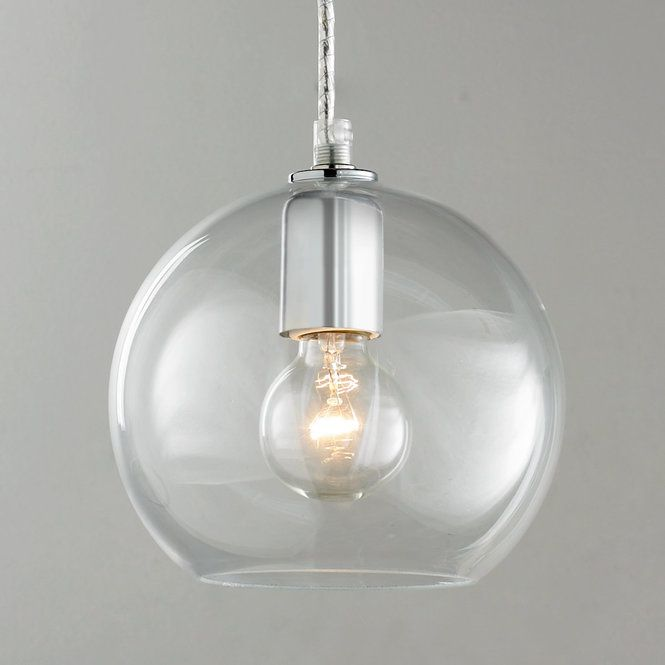"""The Young House Love Bubble glass pendant makes a clear style statement. Hand blown bubble glass shape is simple, understated and chic. This clear glass pendant with chrome hardware has enough character to stand alone yet it looks great in multiples over a kitchen island as well.  This light comes ready to hang with 6' of silver cord and a 4.25"""" diameter chrome ceiling canopy for a finished look. 60 watts (medium base socket).(6.25""""Hx7""""W)"""