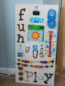 Baby activity board. May be able to make something like this for Lily instead of a regular latch board.