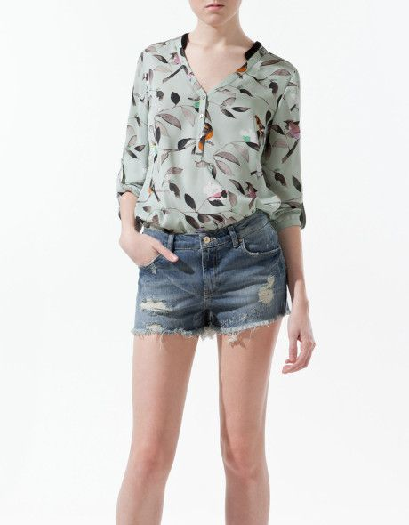 Love the color, bird print, and the v neck collar