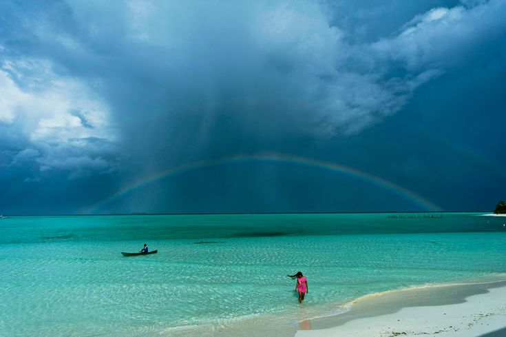 NatGEO Places Winner 2011 - INTO THE GREEN ZONE: A beautiful rainbow after the rain, into the green zone of the Palawan Islands. Onuk island, Balabac Palawan, Philippines. (Photo and caption by George Tapan