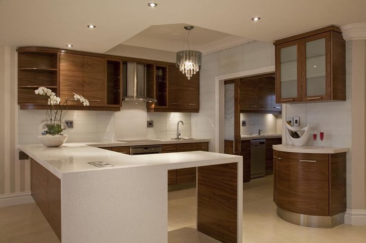 White granite tops, wooden cupboard door finish and detail