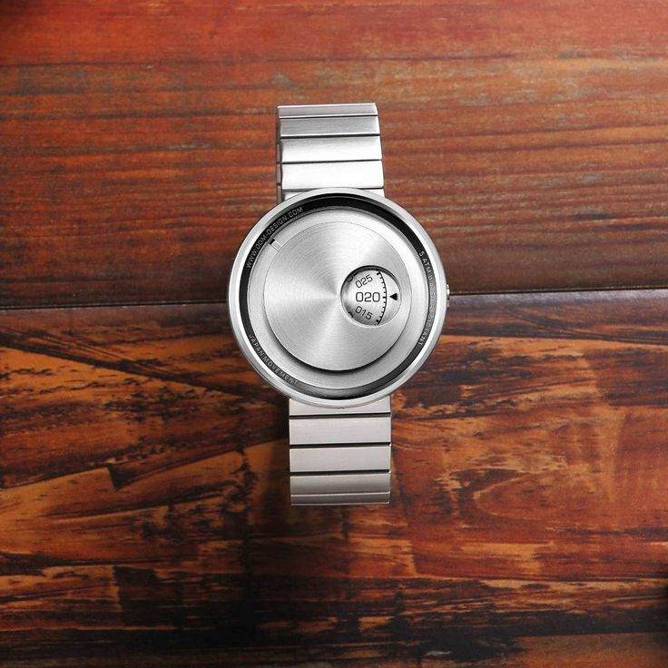 """The Film"" by ODM was inspired by vintage film cameras of the 70s and '80s. Design cues like its circular brushed steel dial with viewfinder aperture to read the minutes are reminiscent of classic cameras of yesteryear. http://ift.tt/2iWDcmx"