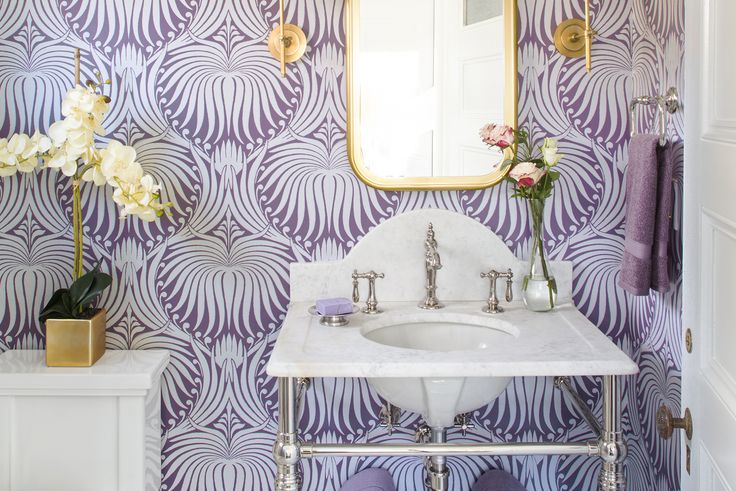 The living room drapery fabric's whites, grays, blues, and lavenders established the color palette for the entire house, including the new powder room. Bath fan: Panasonic Insulation: Roxul Console: Palmer Industries