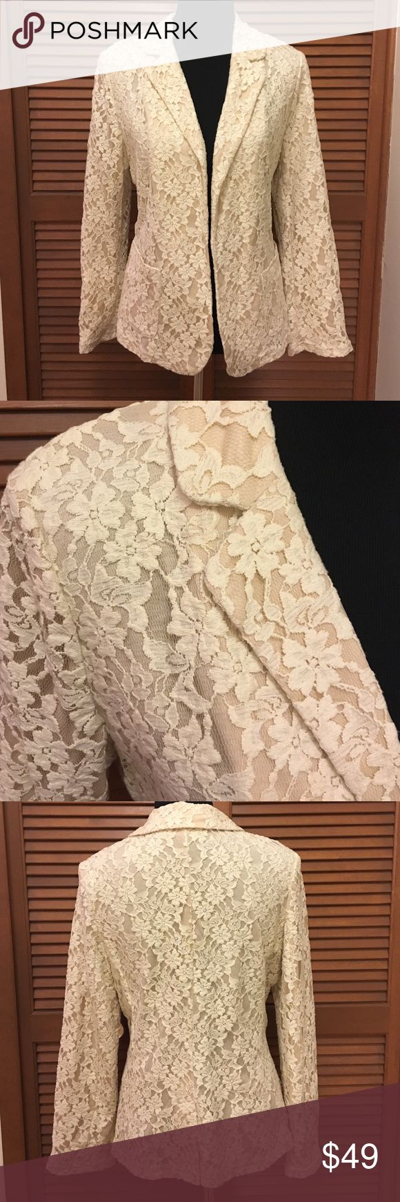 Chico's lace blazer jacket L size 2 cream beige Long sleeve lace blazer jacket from Chico's. Chicos size 2. Lining is beige with cream lace on top. Shell of jacket is 83% cotton 17% nylon. Lining is 100% Modal. Bundle two or more items from my closet and save! Chico's Jackets & Coats Blazers