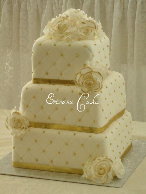 Google Image Result for http://www.erivanacakes.com/photos/Wedding-Cakes/Gold%2520and%2520white%2520wedding%2520cake.jpg