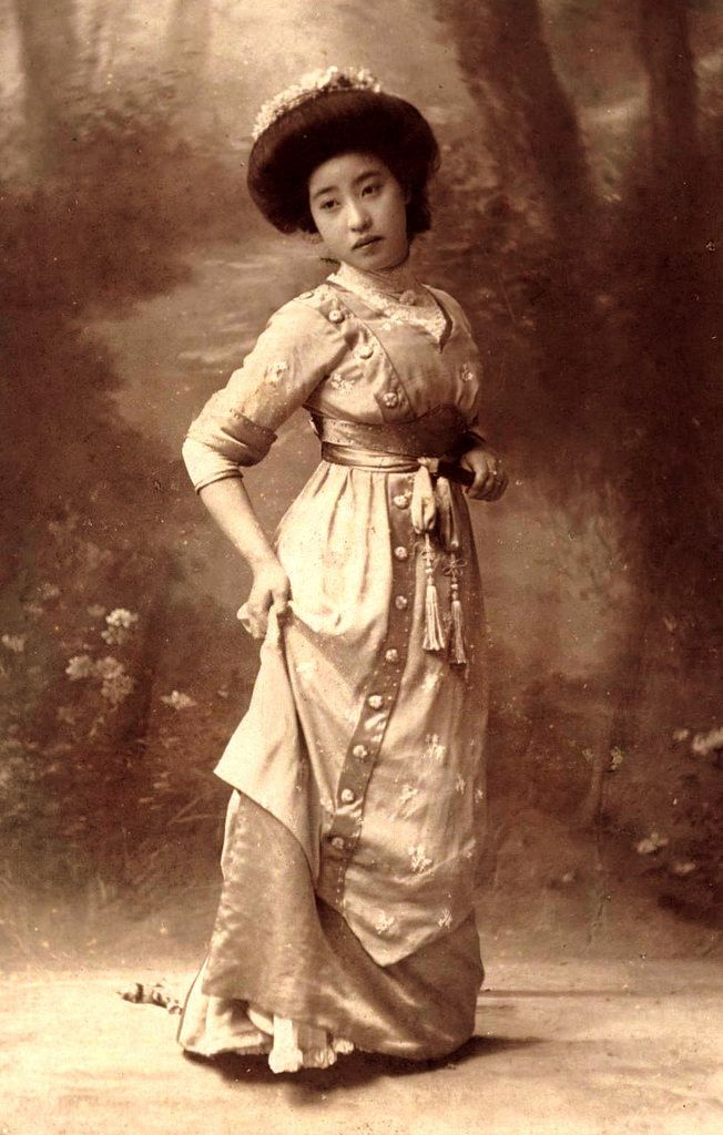 "Ca 1905 Meiji-era Portrait of a Japanese girl experimenting with Western Dress.   Japan's longing for Western Fashion began long ago. Even Emperor Hirohito got tired his own cumbersome native fashions, and decided to go with Western styles for himself after returning from his first trip to Europe as a young man in 1921.   The 1920s also gave rise to the MOGA [Japanese contraction of their pronunciation of the English ""MODERN GIRL""] who reveled in the ""Flapper"" fashions..."