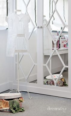 Dress up mirror closet doors with patterns made out of painted wood...