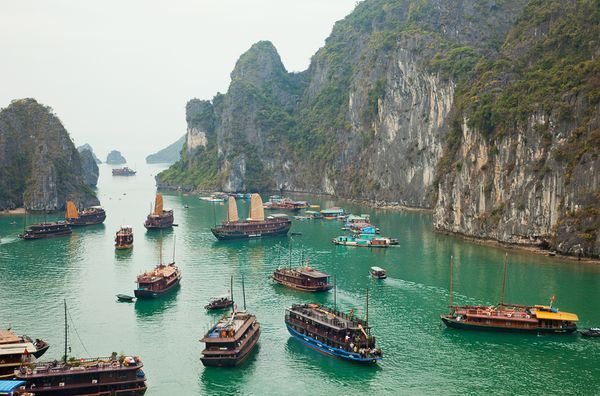 Halong Bay    Photograph by Steven Vidler, Eurasia Press/Corbis    Wooden tourists boats visit a floating fishing village in Vietnam'sHalong Bay, one of the world's new seven natural wonders, as chosen by a global vote.