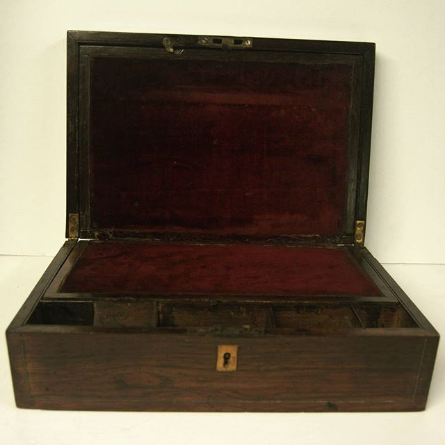 Victorian Rosewood Writing Slope at D and A Binder | We have gorgeous smalls at Binder's. This beautiful writing box has plenty of space for your personal affairs - in fetching rosewood with mother of pearl inlay this is a practical and beautiful box. It has several compartments which lift and hide to ensure security and the inside is lined with a berry velvet. We do not have the original key unfortuanately. There is also brass string inlay. Email us at david@Dandabinder.co.uk or see more…