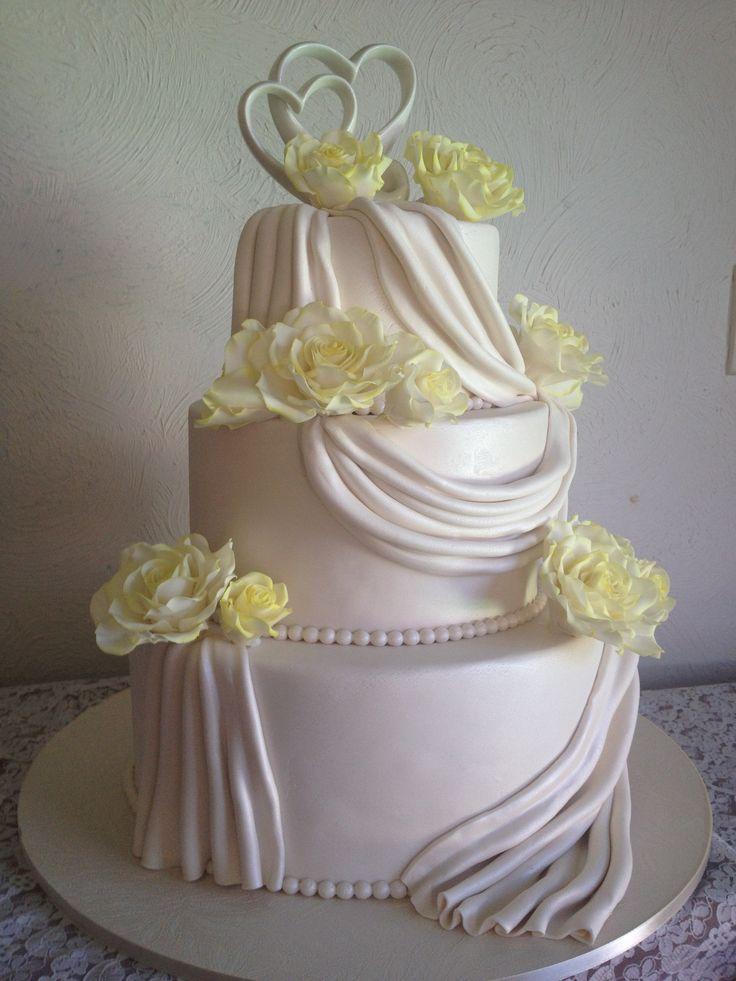 Draped wedding cake with sugar flowers