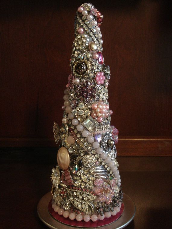 This is such a cool decoration!  It is a tree made out of vintage jewelry!