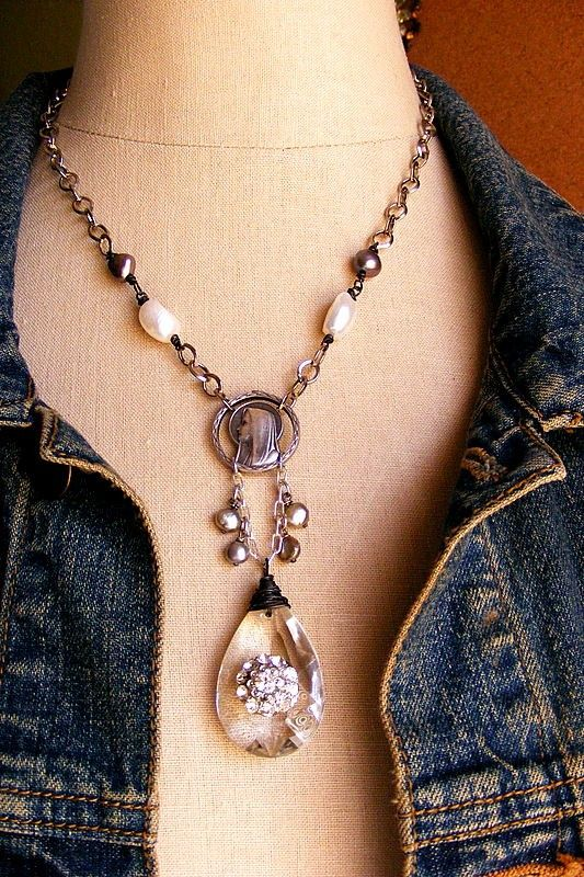 """She is so Divine and full of vintage charm. The inspiration the Vintage Virgin Mary finding. Dangling below is a vintage chandelier crystal accented with a gorgeous vintage rhinestone button. Delicate fresh water pearls alson dangle and add accent. The simple silver tone chain is accented with fresh water pearls. A very pretty and perfectly sparkling Vintage found rhinestone clasp finishes up.   measurments- length-17"""" mary-3/4"""" dangle-2-1/2"""""""