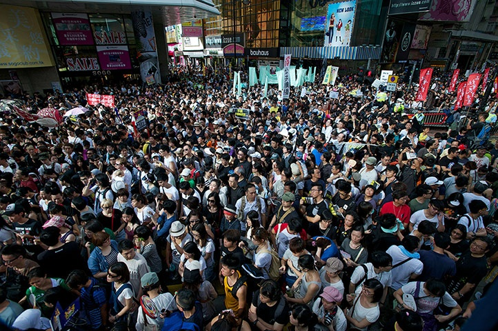 Thousands of protesters chant slogans against new Hong Kong Chief Executive Leung Chun-ying. Hong Kong's new leader took over the territory of 7 million people amid falling popularity ratings, a series of setbacks and protests over his leadership before he even started his term