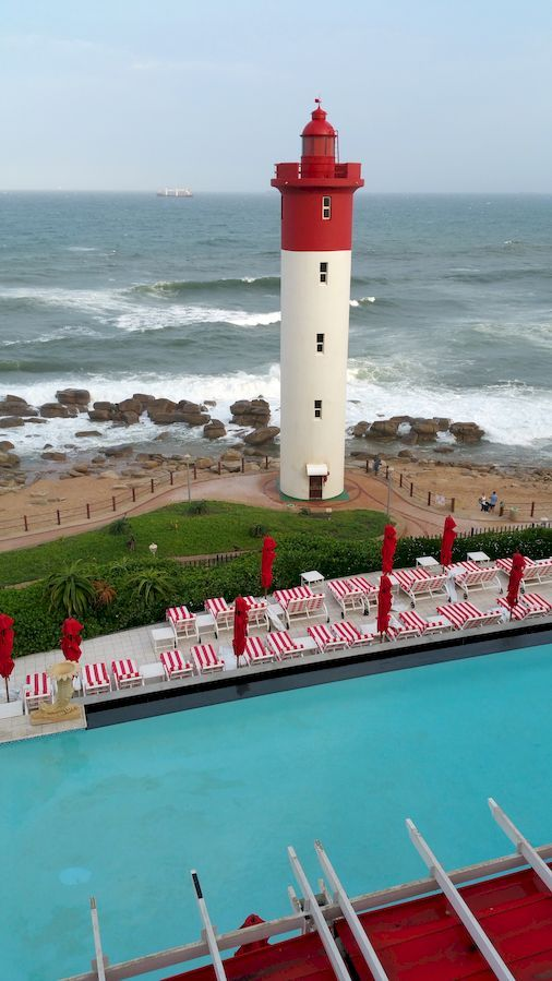 The Umhlanga Rocks Lighthouse from the Lighthouse bar, showing the Oyster Box pool. Photos from our Durban trip in 2016 - Umhlanga week.